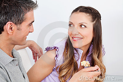 Man feeding woman with cereal
