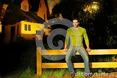 Man on fence