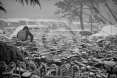 Man Fetching Bike in Snow