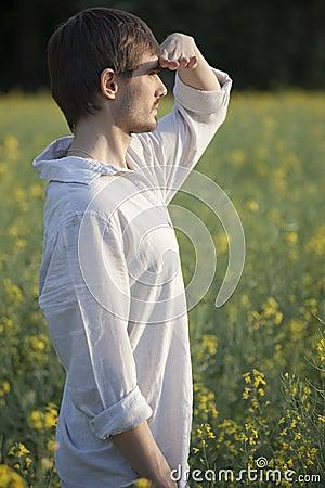 Man in field looking