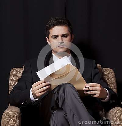 Man with file sitting in vintage armchair