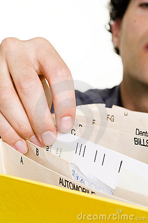 Man filing bills