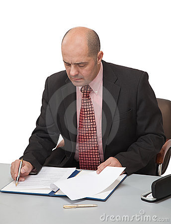 Man fills the papers, sitting at the table