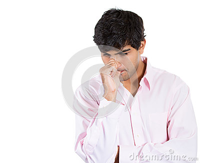 Man with finger in mouth sucking thumb or biting fingernail in anxiety and stress