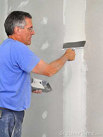 Man finishing drywall