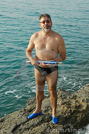 Man with fishing harpoon