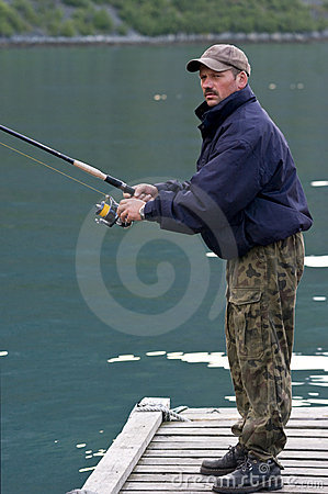 Man fishing on jetty