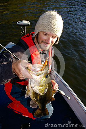 Man Fishing For Largemouth Bass in Cold Weather