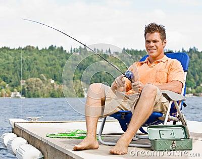 Man fishing on pier