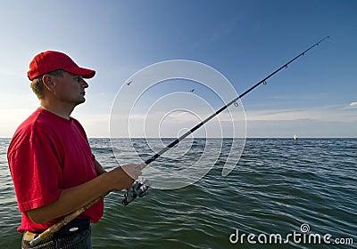 Man fishing at sea