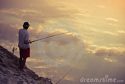 Man fishing in the sky reflection