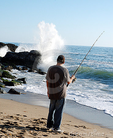 Man fishing and whaching wave
