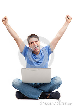 Man with fists up using laptop