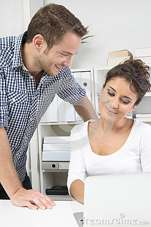 Man flirting with his colleague in office