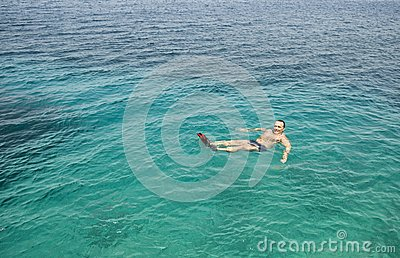 Man floating in the sea.