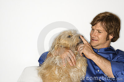 Man with fluffy brown dog.
