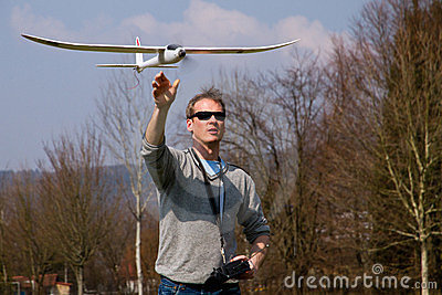 A man flying a model plane