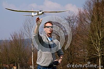 A man flying a model plane