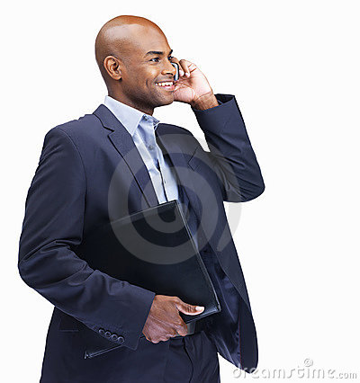 Man with folder while talking on cellphone