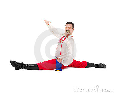 Man in folk ukrainian costume makes splits
