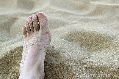 Man foot in summer beach sand royalty free stock photo image