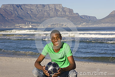 Man With Football On Table Mountain Beach