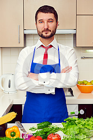 Man in formal wear and blue apron