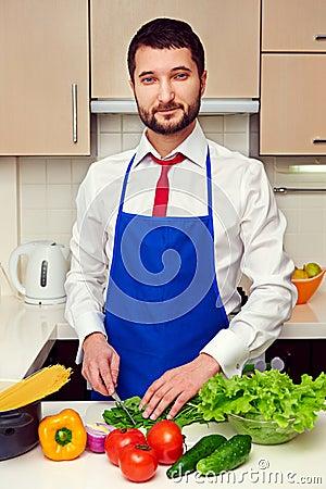 Man in formal wear preparing salad