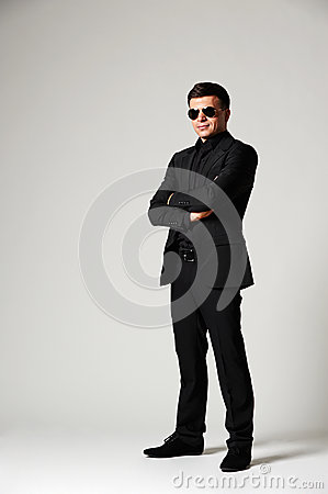 Man in formal wear and sunglasses
