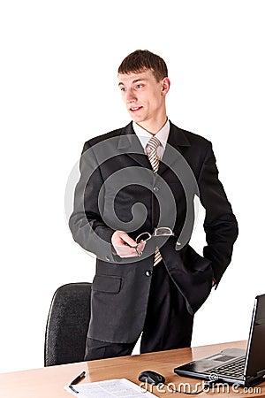 Man in formal wear thinking, workplace
