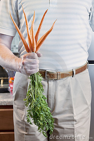 Man with Fresh Carrots