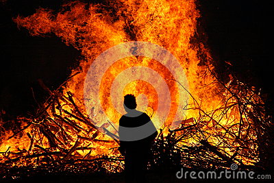 Man in front of a bonfire