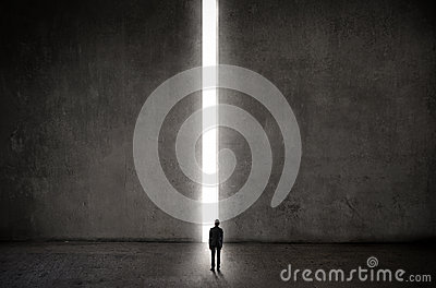 Man in front of a lighted up way