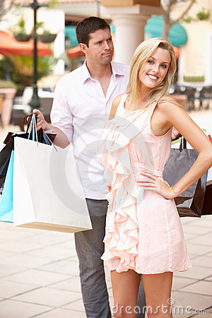 Man Frustrated With Woman Shopping