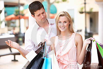 Man Frustrated With Woman On Shopping Trip