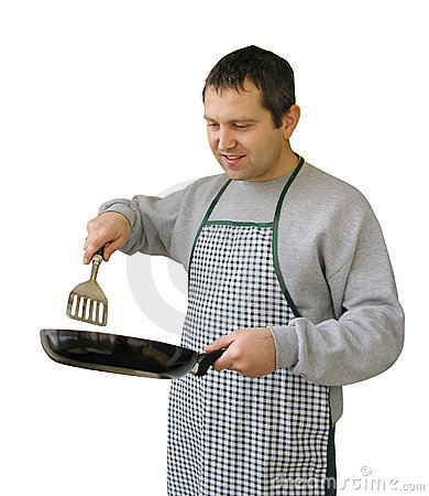 Man with frying pan cooking