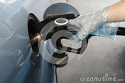 Man fueling car with diesel