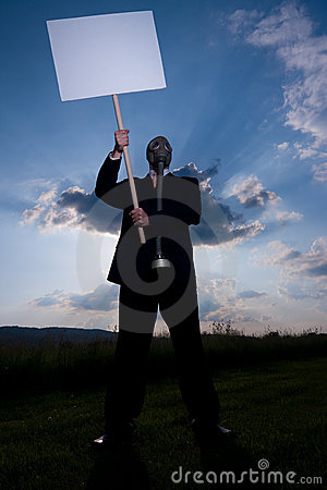 Man in gas-mask with placard