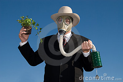 Man with gas mask & plant.