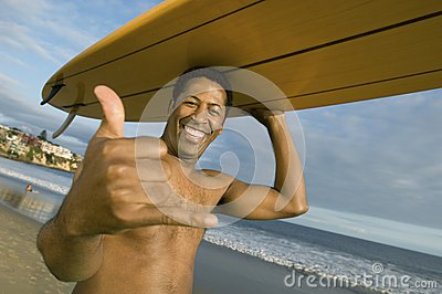 Man Gesturing While Carrying Surfboard On Head