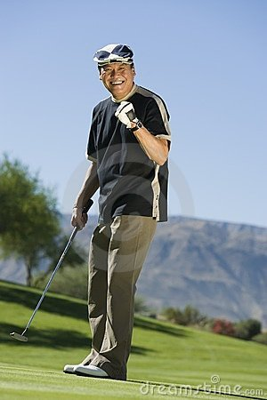 Man gesturing on golf course