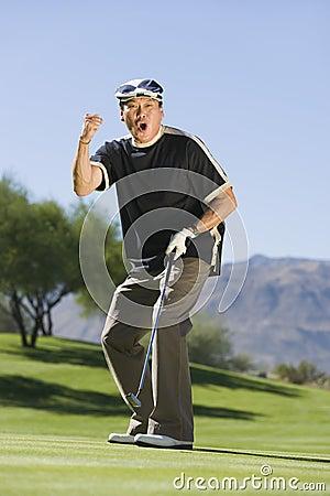 Man gesturing on golf course