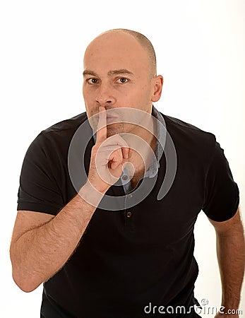 Man gesturing for quiet