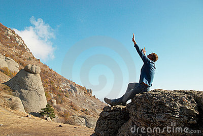 Man gesturing with raised arms