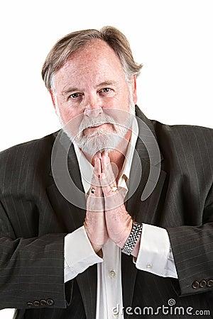 Man gesturing to pray