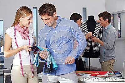 Man gets advice at custom tailor