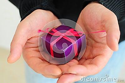 Man gifting small present