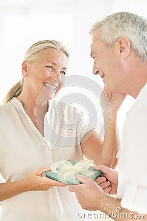 Man Gifting Woman At Home