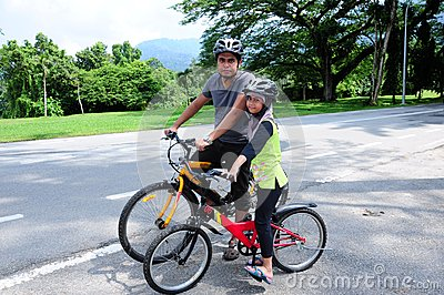 Man and young Girl Cycling