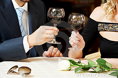 Man and girl hands with wine at cafe on a date
